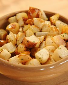 """Roasted Turnips and Pears with Rosemary-Honey Drizzle   Topped with herb-laden honey butter, earthy turnips and seasonal pears make a memorable side dish. This recipe comes from Susie Middleton's """"Fast, Fresh & Green"""" cookbook.Also try: Vanilla and Cardamom-Glazed Acorn Squash Rings, Roasted Brussels Sprouts with Orange-Butter Sauce"""