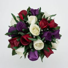 Rich Jewel Tones Of Red And Purple Are Accented With Ivory In This Bridal Bouquet Featuring Roses Lush Lisianthus