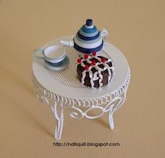little table with tea cup and pot and a cake... how CUTE ~!~