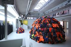 "During Milan Design Week 2017 at its Via Pontaccio showroom, MOROSO presented the work ""SOS"" - Save Our Souls by 16-year-old young artist Achilleas Souras. A socially powerful installation assembled from hundreds of life jackets retrieved from the many thousands left on the shores of Lesbos Island by arriving migrants.   Photo by Alessandro Paderni."