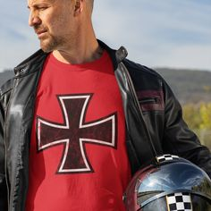 """The Iron Cross (a black cross pattée) was a former military decoration and a symbol of armed forces in Prussia, and later in Germany. In this case, on the red background, the shirt reminds as of the famous """"red baron"""" Manfred von Richthofen, the ace of aces in the First World war. #luftstreitkräfte #luftwaffe #eiserneskreuz #ironcross Manfred Von Richthofen, Military Decorations, Prussia, Luftwaffe, Baron, Red Background, Armed Forces, First World, World War"""
