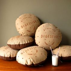 British Biscuit Cushions by Nikki McWilliams. Very cute.