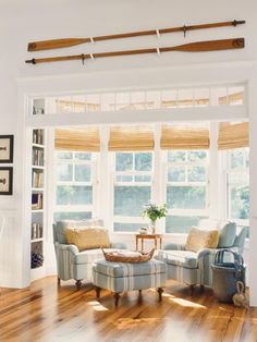 "Bamboo roman shades, floors, chairs, bookshelf, etc. ""lots of sunny windows, easy care flooring"""
