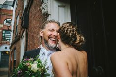 groom laughs with bride