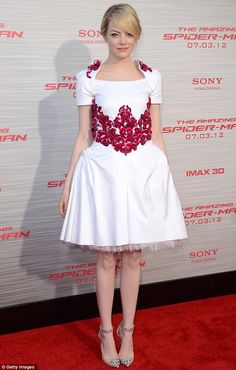Emma Stone in Chanel dress and Christian Louboutin shoes.  (March 2012)