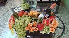 Vino y duraznos, arreglos frutales finos