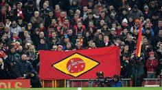 """Reds supporters unveiled a homemade flag and sang a powerful version of """"You'll Never Walk Alone"""" as they paid their respects to the victims of Monday's plane crash"""