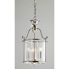 The elegant lines of this beautiful nickel chandelier will attract glowing praise from visitors to your home. With clear glass panes and finished nickel accents, this piece brings undeniable charm to your living space and is hardwired for easy use.