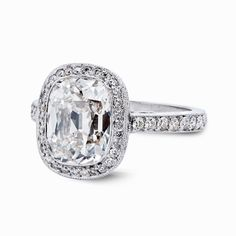 Antique Cushion Cut Diamond Ring  Pronounced and bold, the bezel set antique cushion on this piece features a high table that protrudes from the ring. The pave setting around the main gemstone [...]