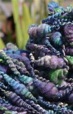 Art yarn spun from hand dyed merino/milk tops.