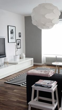 Minimalist décor in white, black and grey create the perfect scandi base for your home. Simple wall decoration and hints of wood in furniture add the final touches to the look. Great for bedrooms and living rooms.
