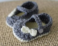 Crochet Baby Booties made in Grey and Off White with a Tiny Crochet Bow Detail.    The texture on these booties is amazing! Softest of Soft Acrylic