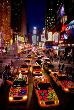 Times Square, NYC ~ The 'Flower Taxis' were a part of a series of public art projects called Portraits of Hope.