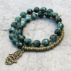 Abundance, Moss agate 27 bead mala bracelet with a Hamsa hand charm™