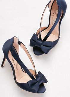 af31b3f0d4 A pop of something blue for your wedding day with these navy peep toe bow  heels