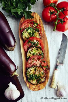 This low calorie eggplant recipe is very easy to make and I am sure you are going to love it. Vegan, low carb, gluten free and paleo friendly. These marinated eggplants and tomatoes can be served as an appetizer, as a side dish, in place of a salad, or just by themselves. They are that good.
