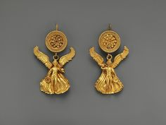 Pair of Greek gold earrings depicting Eros. They date to around 300 BCE. From the Metropolitan Museum of Art.