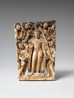 7-8th C. Buddha surrounded by attendants and celestial beings, prepares to descend to earth to teach his mother the Buddhist dharma, as she had died shortly after his birth. This was an important miracle in Kashmir, Gandhara, and, later, Tibet. Ivory portable shrine. Kashmir India