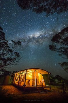Camping & Tents   Starry sky about warmly lit tent at night