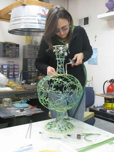 Keri Russell-Pool Building Here I am working on a similar piece which gives you some idea of the scale and how the hand torch alows me to move around the body of the piece. Art Nouveau, Art Deco, Keri Russell, Building A Pool, Lampworking, Some Ideas, Artist At Work, Pottery Art, Vases