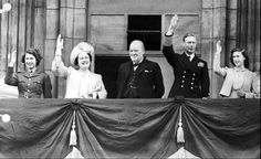 Britain's Prime Minister Winston Churchill, center, joins the royal family, from left, Princess Elizabeth, Queen Elizabeth, King George VI, and Princess Margaret, on the balcony of Buckingham Palace, London, England, on VE-Day on May 8, 1945. (AP Photo)