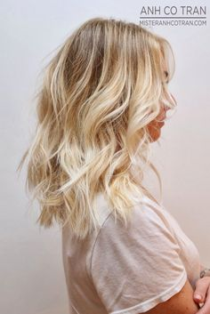 Medium long textured layered hair with pretty loose waves