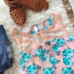 Sheer Peach and Teal Floral Crop Top Sheer peach and teal floral crop top. Never been worn, no snags or wear and tear. Listing includes only the crop top, all other items are only being used for display. Xhilaration Tops Crop Tops