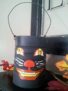 tin can painted Painted Tin Cans, Planter Pots, Canning, Halloween, Home Canning, Conservation, Spooky Halloween