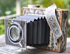 The camera is made from recycled products like a biscuit box, toilet roll and bottle covers. Description from luv2scrap-pages.blogspot.co.uk. I searched for this on bing.com/images