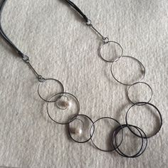 Montserrat Lacomba. Circle Necklace with Pearls. Oxidized silver and copper, cultivated pearls and leather.