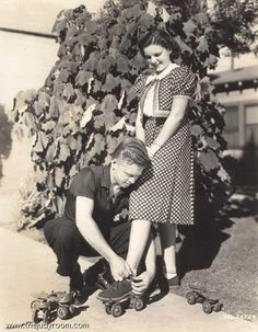 Mickey helping Judy with her roller skates