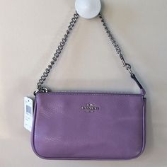 "Coach lavender leather handbag/wristlet NWT Lavender pebbled leather handbag/wristlet, silver tone hardware, 1 side pocket, 2 card slots. Switch from handbag to wristlet in one click! 7.5x4.5x2"". Coach Bags Mini Bags"