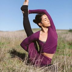 """""""Falling in love doesn't have to include another person. Sometimes all you need is yourself."""" – r.h. sin. @michelleweinhofen is featured in the Amelia Long Sleeve Crop & Goddess Legging in Juneberry. #aloyoga #beagoddess"""