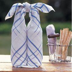 Use a linen tea towel to transport wine bottles on a short trip.