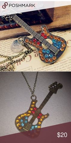 Guitar Necklace Nwot bronze guitar necklace. The chain is about 27 inches. Jewelry Necklaces