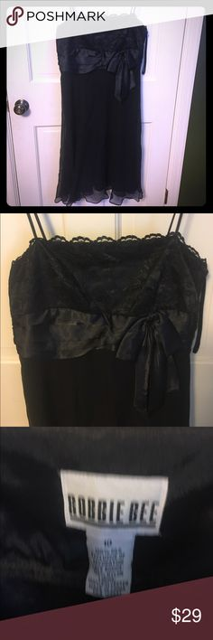"""Little black strappy satin dress size 10 LBD with spaghetti straps, side zip, ruffles and bow on the bodice. Sheer overlay skirt perfect for cocktail parties or an evening on the town. Worn once, size 10. Falls just below the knees for someone 5'4"""". Robbie Bee Dresses"""