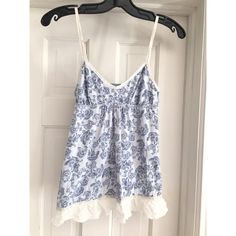 NEW LISTING NWOT A&F Blue, White Flower Blouse NWOT Abercrombie & Fitch Blue and White Flower Blouse  Perfect for spring/summer    Condition: New w/o tags, Never worn Size: Small Material: 100% Cotton  ✔️Offers welcome✔️Questions welcome✔️  No trades    Bundle & Save   Abercrombie & Fitch Tops Blouses