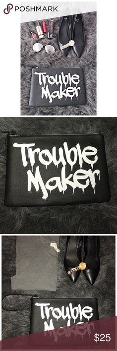 """NWT Trouble Maker Large Black Statement Clutch New Large black Statement clutch that says """"trouble maker"""". The clutch is black with white lettering, it is large and can even fit a mini iPad or small notebook. Super cute and there are currently a FEW available so you can snag one for you and your bff! Removable wrist strap and zipper closure. One of my personal faves. Bundle and save! Free gift with every $20 purchase. Bags Clutches & Wristlets"""