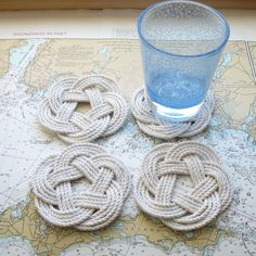 Mystic Knotwork: White Cotton Nautical Sailor Knot Coasters. Use with mugs, glasses, and cold bottles of beer. The cotton will absorb any moisture saving your tabletop. These coasters come in a set of four and measure 4 inches across. They are tied with the same knot as our famous sailor knot bracelets, just turned flat.