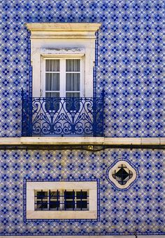 Estremoz, Portugal, azulejo/tile covered building with window with a balcony detail