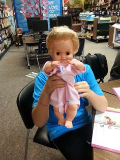 Having some fun with the dolls during a class at Lord Nelson school in East Vancouver :)  Students learn how to change & hold small children in our Red Cross Babysitting Course .