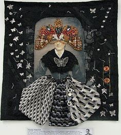 This entry into the PowerSuite Challenge was titled: Victorian Power Suit. It was created by Linda Morgan a very talented collage artist. You would never know she wasn't a textile artist after looking at this piece! I believe that this is her very first quilt!!!! The upside down butterfly mask is all hand beaded. The back ground is layered with mens suiting, lace, butterfly charms and buttons. Queen Victoria's skirt was made from men's ties.