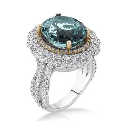 <br><br> <li>1 3/4ct Green Tourmaline and White Diamond ring</li> <li>18k Two-tone Gold jewelry</li> <li><a><a href='http://www.overstock.com/downloads/pdf/2010_RingSizing.pdf'><span class='links'>Click here for ring sizing guide</span></a></li>