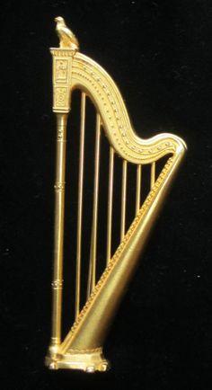 Karl Lagerfeld Gold Harp pin
