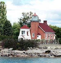 LITTLE TRAVERSE (HARBOR POINT) LIGHT     State: MICHIGAN  Location: NORTH SIDE LITTLE TRAVERSE BAY / LAKE MICHIGAN   Nearest City: HARBOR SPRINGS  County: EMMET  U.S.C.G. District: 9  Year Station Established: 1884