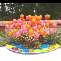 Pineapple cake pop dessert table.