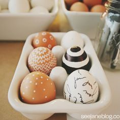 Tired of the traditional tie-dye approach? Step things up a notch with hardboiled brown and white eggs (for a subtle contrast) decorated with Sharpie permanent markets.