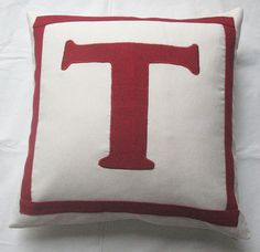 Got these for my living room! off white and dark red monogrammed pillow by Comfyheavenpillows, $28.99