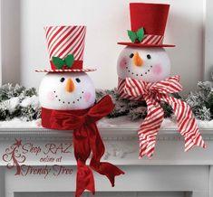 raz-peppermint-toy-santa-head-swirled-top-hat-tree-topper-trendytree