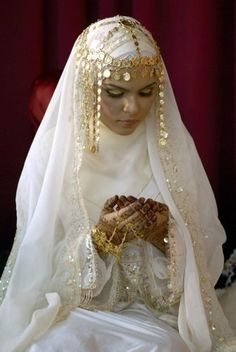 Love the head jewelery supposedly arabian   THE BRIDE WEARS HIJAB: modest wedding dresses